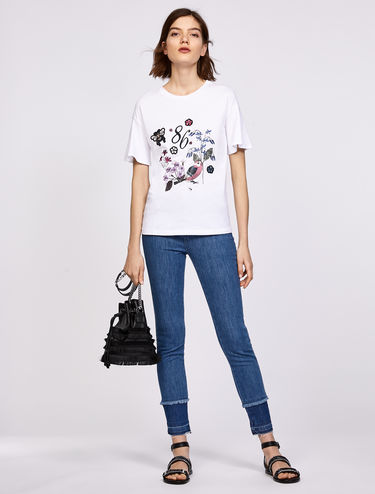 T-shirt with appliqués and prints