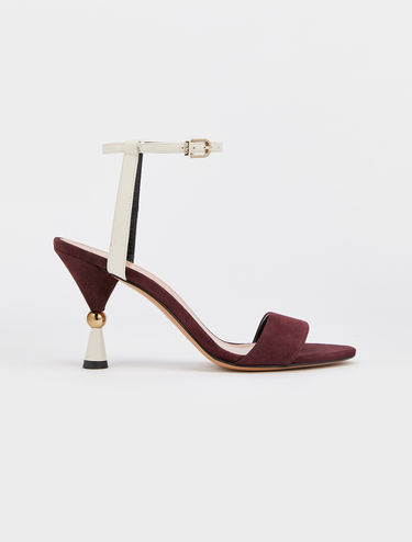 Sandals with hourglass heel