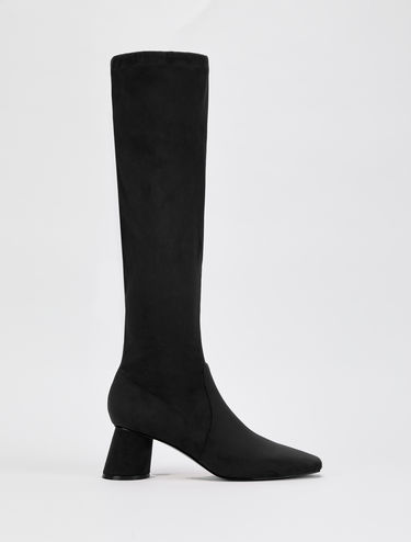 Slim boots with slanted heel