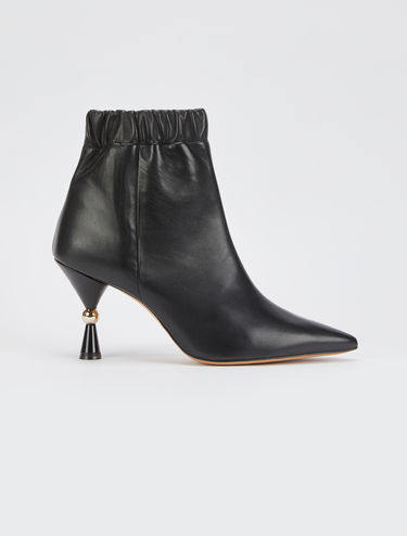 Ankle boots with hourglass heel