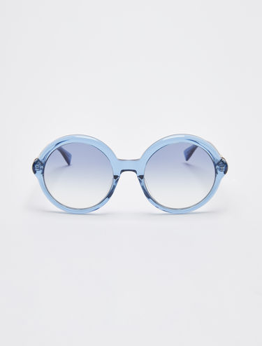 Round transparent coloured sunglasses