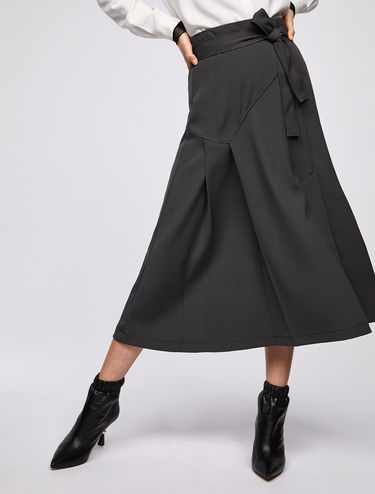 Midi-skirt with asymmetric pleating