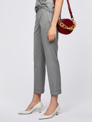Slim-fit trousers with turn-up cuffs