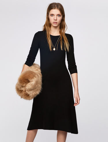 Knit dress with asymmetric hem