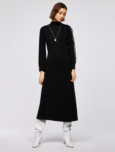 Knit dress with lace ruffles