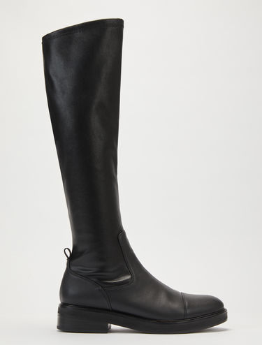 Boots in leather and stretch fabric