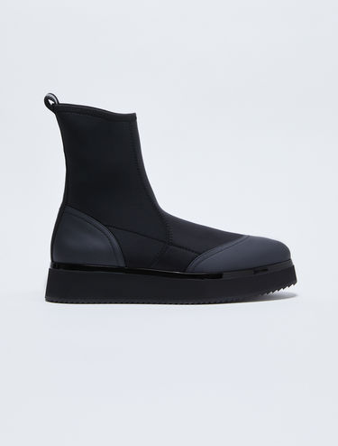 Flatform boots in technical jersey and leather