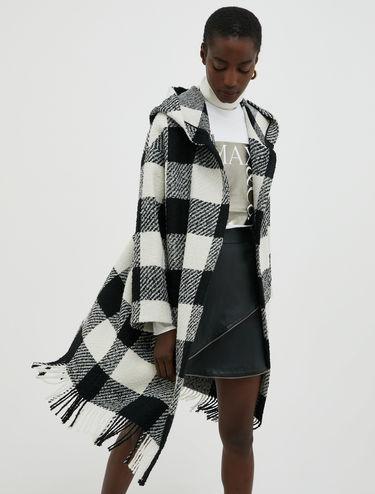 Manteau en laine bouclée avec franges