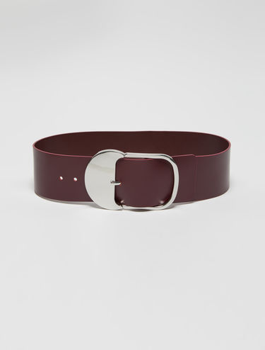 Wide belt with oversized buckle